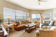 3 bed/2 bath Oceanview condo sleeps 8. Short walk to beach, pool & hot tub.