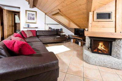 Lounge with leather sofa's and cosy log fire