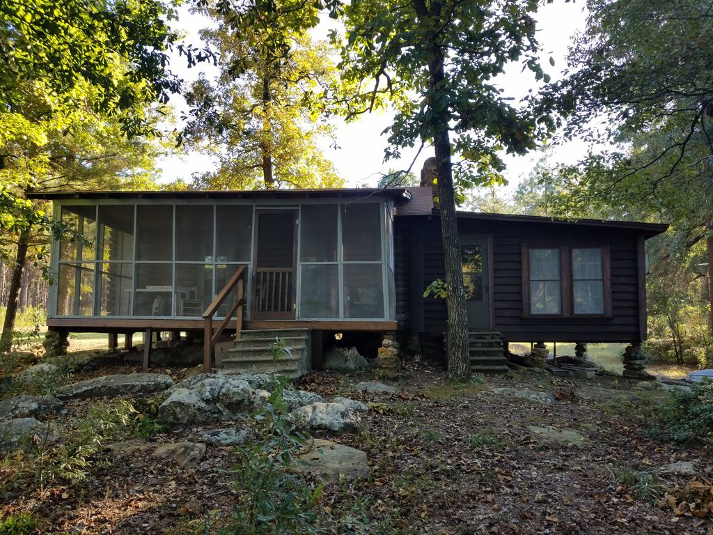 Secluded 1930 39 s log cabin on east texas private fishing for Lake cabin rentals near dallas