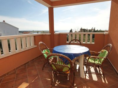 Photo for Two bedroom apartment with terrace and sea view Novalja, Pag (A-9336-b)
