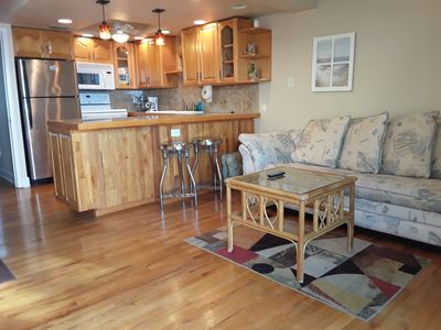 Living room and kitchen.  Hardwood floors throughout