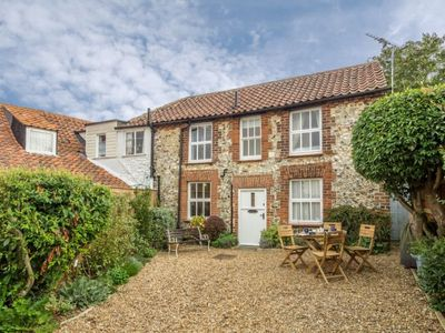 Photo for A picturesque 18th century flint cottage in a quiet side road in Brancaster