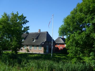 Photo for Beautiful thatched cottage on the German-Danish border near Sylt