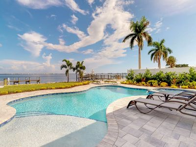 Photo for NEW LISTING! Bayfront & dog-friendly home w/private boat dock, pool & spa