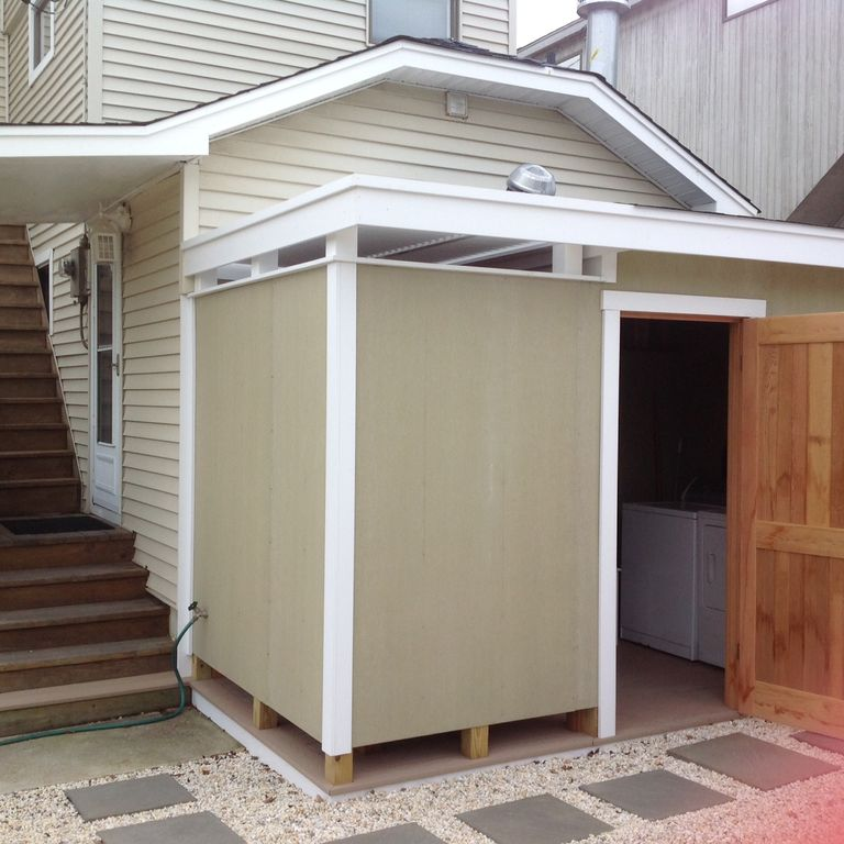Outside Shower And Laundry Room With Washer Dryer Storage For Beach Bag Towels