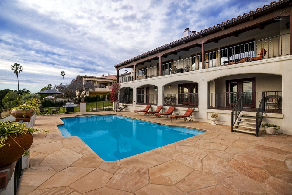 The Deck, Pool, And Hot Tub Combine To Make Lounging Here A Memorable  Experience