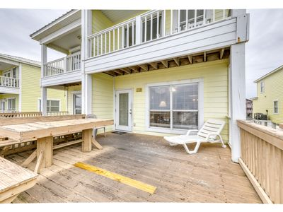 Photo for Gulf front beach retreat with private beach access & shared pool