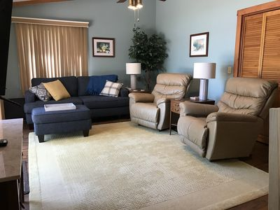 Great room with two recliners facing the lake
