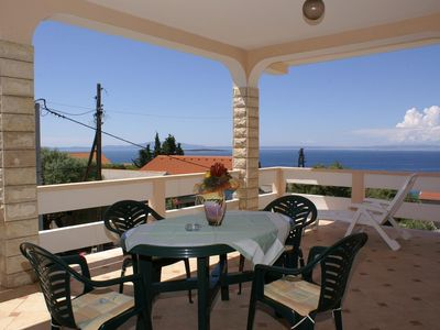 Photo for Two bedroom apartment with terrace and sea view Lun, Pag (A-4062-a)