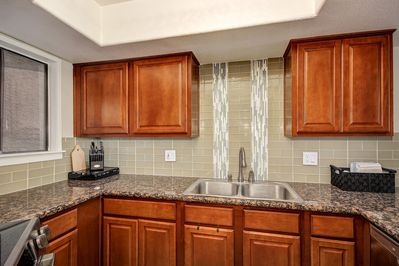 Kitchen with Granite Counters and Glass Backsplash