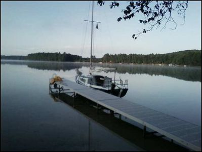 Your on-site 50' dock, on the glassy surface of Guthrie Lake.
