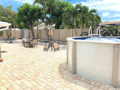 Photo for LARGE POOL HOME CLOSE TO THE BEACH. GRILL OUTSIDE!
