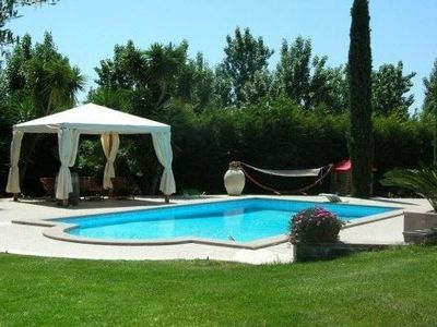 Photo for Apartment in villa, large garden, swimming pool, spa, near the sea Rome