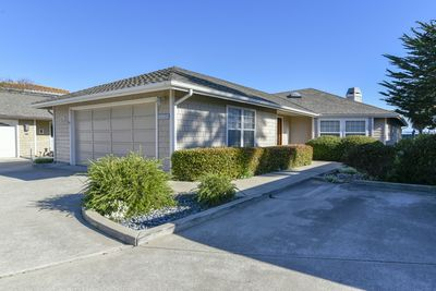 The home is beautifully landscaped and has parking for 3 cars.