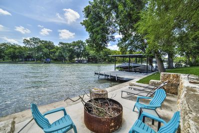 Sitting area with fire pit and dock.