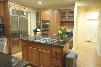 Kitchen with center island, stainless steel appliances, and double oven.