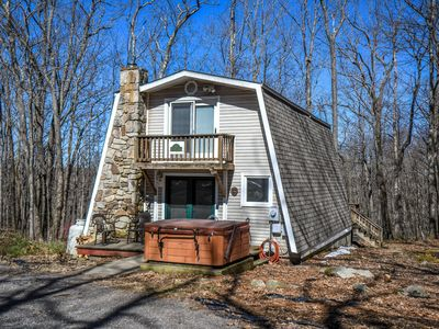 Photo for Charming cabin within 5 minutes from lake activities with a hot tub!