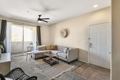 Entry way leads right to the living room with TV & balcony
