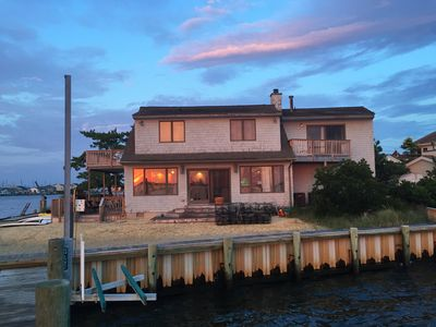 View from the end of our dock on the bay.  Sunset reflection in windows