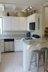 Newly Remodeled Kitchen with Granite Counter-tops and all the Amenities.