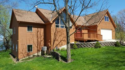 Photo for Unique family home overlooking beautiful Wind Lake with 117' lake frontage.