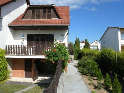 Holiday house with balcony and garden furniture