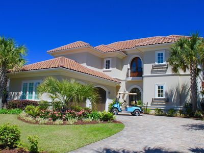 Photo for Escape to a private pool, large living space, 6 seater golf cart and steps from