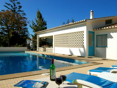 Photo for Spacious villa with large private gardens, heated pool and close to beach