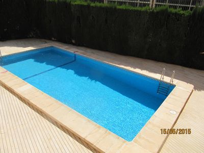 Photo for Superb apartment at the beach of Gandia with pool.