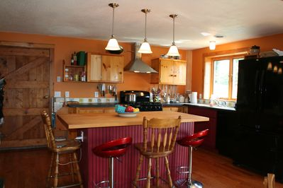 Kitchen with butcher block island - seats 4 comforably