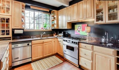 Gourmet kitchen equipped with new Kitchenaid Pro appliances