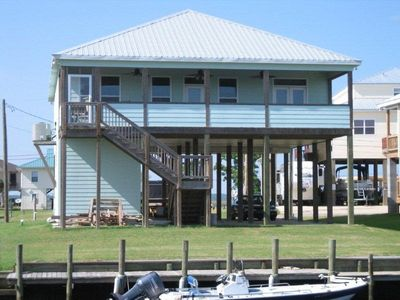 back porch facing canal and boat dock