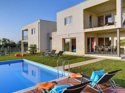 Photo for Luxurious villa with heated private pool, 3 bedrooms, 2 bathrooms, WiFi, air conditioning, parking, terrace and barbecue area