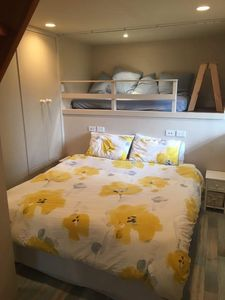 The loft bed is located behind the super king size bed