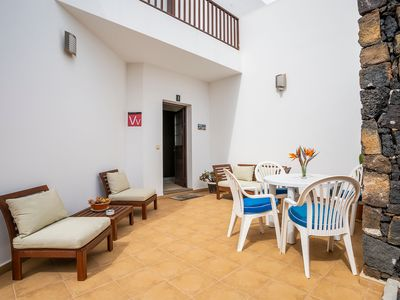 Photo for Gorgeous Apartment A Short Drive from Beaches with Spacious Terrace & Wi-Fi; Parking Available