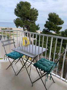 Photo for beachfront apartment with stunning views (feet in the beach)