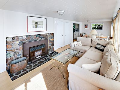 Living Area - Enjoy the allure of a wood-burning fireplace in the living room.