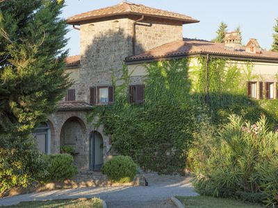 Photo for Nice apartment with WIFI, pool, patio, panoramic view and parking, close to San Gimignano