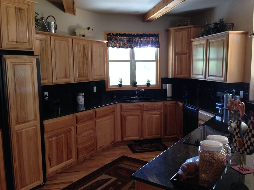 two suite 3 bdr home on the fox acres golf course with a forest in