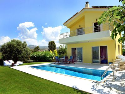 Photo for Dimitra's Yellow Villa is located close to the beach and hosts up ...