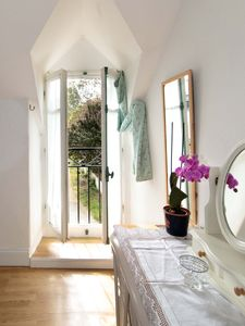 Dressing table and view out of French windows