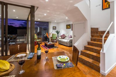 Living room, spiral stairs and dining room