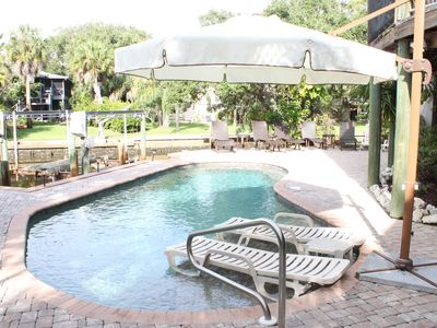 Pool, sundeck, umbrella, Jenn-Air Grill, lower level dining. Located on canal