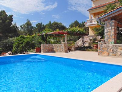 Photo for This 5-bedroom villa for up to 9 guests is located in Zadar and has a private swimming pool and Wi-F