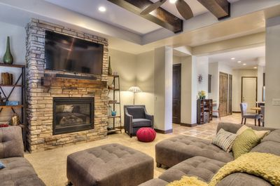 """Great Room with 60""""TV, reading chair, large sectional, and game table"""