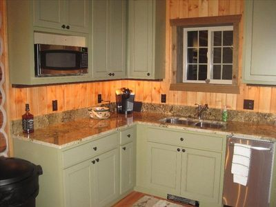 New kitchen furnished to a gourmet's delight.