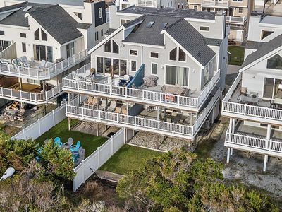 Photo for Free Internet. Beautiful courtyard. 3 Decks with views from Atlantic City to Avalon. Watch the sun rise off the front decks and sunset off the back decks