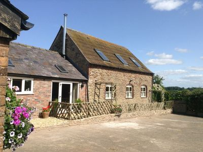 Photo for Harry,s House barn conversion,3 en- suite bed and contemporary woodburner, views