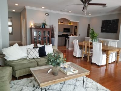 Comfortable Open Concept Main floor with Farmhouse Dining Table seats 6+.