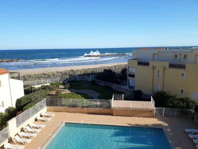 Photo for Charming beachfront apartment in private residence with pool 4/6 pers
